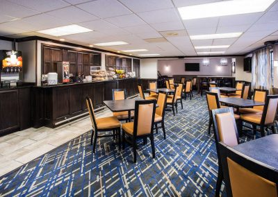 Baymont Inn and Suites Madison WI Breakfast Room Hot Continental Breakfast Food Table and Chairs
