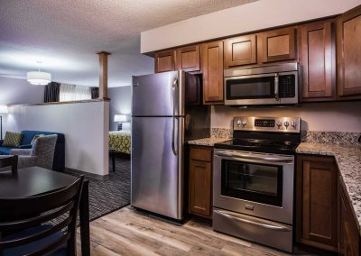 Baymont Inn and Suites Madison WI Extended Stay Apartment Kitchen Stainless Steel Appliances and Granite Countertops