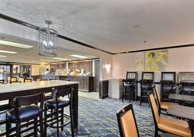 Baymont Inn and Suites Madison WI Breakfast Room Table and Chairs Hot Continental Breakfast Food
