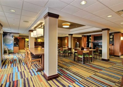 Fairfield Inn and Suites Milwaukee Airport Breakfast Room Chairs Tables