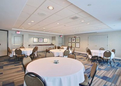 Holiday Inn Express Milwaukee Airport Meeting Room Banquet Round Tables Clothed Chairs