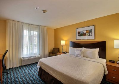 Fairfield Inn and Suites Milwaukee Airport One King Bed Nightstands Window Chair Desk