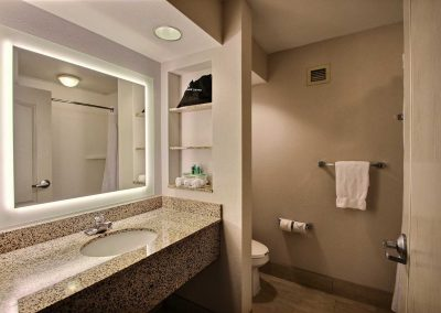 Holiday Inn Express Milwaukee Airport Bathroom Granite Sink Backlit Mirror