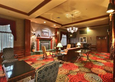 Holiday Inn and Suites Madison WI Lobby Leather Couch Fireplace Chandelier Mahogany Wood