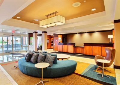 Fairfield Inn and Suites Milwaukee Airport Front Desk Lobby Blue Couch