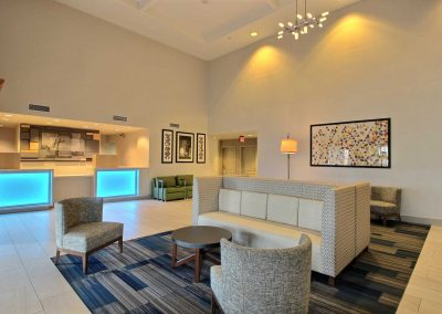 Holiday Inn Express Milwaukee Airport Lobby Modern Seating Lobby Blue Lights