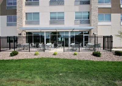Holiday Inn Express Fond du Lac Patio Green Grass Wrought Iron Fence