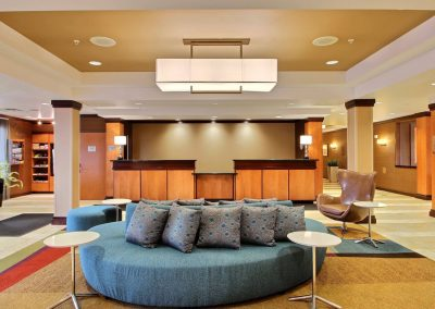 Fairfield Inn and Suites Milwaukee Airport Lobby Front Desk Blue Round Couch