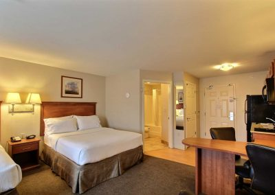 Candlewood Suites Milwaukee Airport Two Beds Suite Full Kitchen Bathroom Desk and Chairs