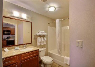 Candlewood Suites Milwaukee Airport Bathroom Granite Sink Tub Shower